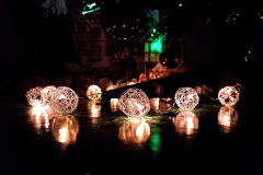 Christmas-tree-bauble-lights-lit-up-reflecting-on-a-table-surface