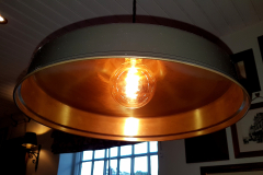 Metallic-light-fitting-in-a-restaurant