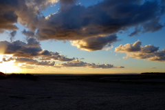 Dusk-sky-over-Barmouth-beach-with-interspersed-clouds