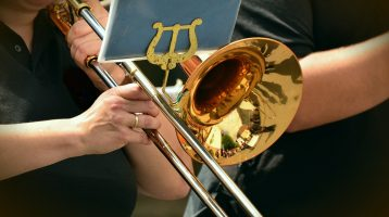 Image of someone playing the trombone